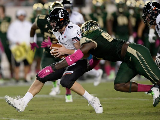 Cincinnati quarterback Hayden Moore (8) is sacked by South Florida defensive end Mike Love (98) during the first half of an NCAA college football game Saturday, Oct. 14, 2017, in Tampa, Fla. (AP Photo/Jason Behnken)