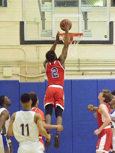 Eagle Kimar Edwards slams the ball through the bucket