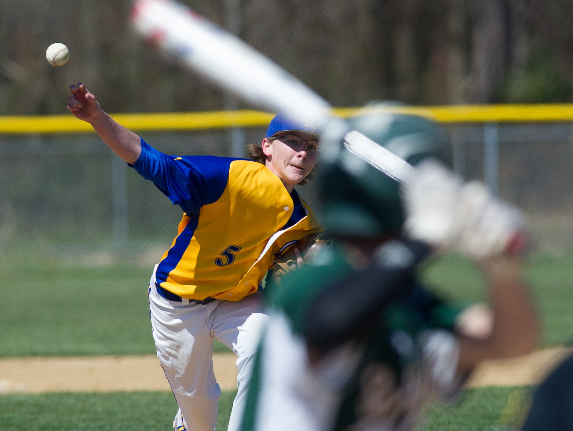 Caesar Rodney's pitcher Steven Platt (5) sends a pitch to the home plate in their game against St. Marks.