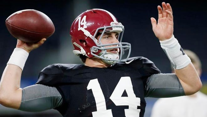 Alabama quarterback Jake Coker (14) looks to throw a pass during a practice for the NCAA Cotton Bowl college football game against Michigan State Sunday in Arlington, Texas.