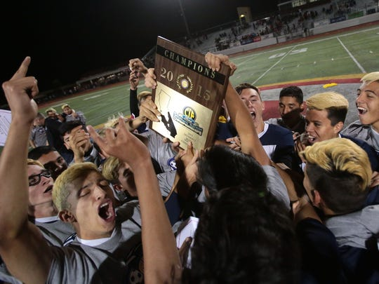 La Quinta celebrates the 3-2 win over Santa Ana for the CIF Southern Section Division 2 boys soccer championship title on Friday in Corona.