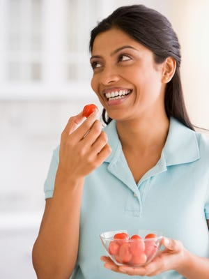 Eating tomatoes is a healthy snack.