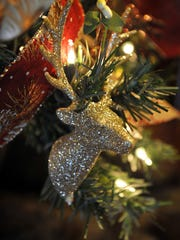 Sparkly reindeer heads and woodland color tones on a Christmas tree decorated by Chip Kouri for the Oh! Christmas Tree auction event November 16th at The Forum.