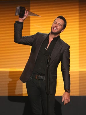 Luke Bryan accepts the award for favorite country male artist at the 42nd annual American Music Awards on Sunday.