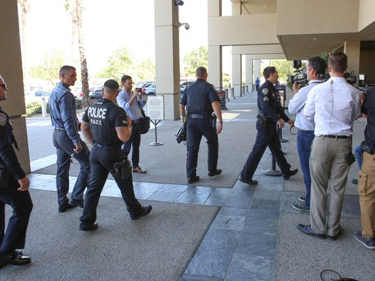 Palm Springs Police Officers walk into the Larson Justice Center to attend the arraignment of John Felix, the man accused of murdering two Palm Spring Police Officers Oct. 8, in Indio, Ca., Oct. 13, 2016.