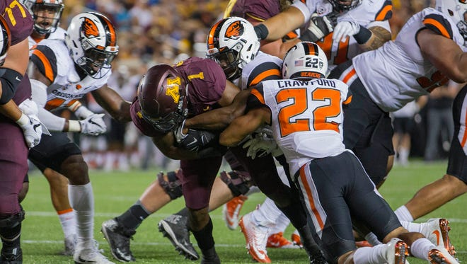 Sep 1, 2016; Minneapolis, MN, USA; Minnesota Golden Gophers running back Rodney Smith (1) rushes for a touchdown past Oregon State Beavers cornerback Xavier Crawford (22) in the second quarter at TCF Bank Stadium. Mandatory Credit: Jesse Johnson-USA TODAY Sports