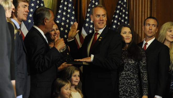 Rep. Ryan Zinke, R-Mont., taking the oath of office during a ceremonial swearing-in in Washington in January 2015, face Democrat Denise Juneau in his bid for re-election.