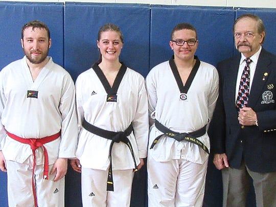 Black belts from April testing for Stevens Taekwondo