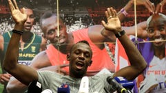 Jamaica's sprinter Usain Bolt gestures during a news