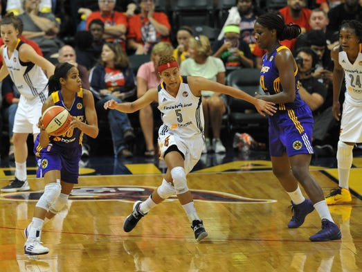 Indiana's Layshia Clarendon tries to cover LA's Lindsey Hardin, left, and Jantel Lavender in the third quarter as the Los Angeles Sparks defeated the Indiana Fever 86-78  at Bankers Life Fieldhouse Tuesday July 15, 2014.