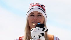 Lindsey Vonn (USA) celebrates winning the bronze medal