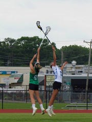 Lily Belle Baker (left) goes for the ball during the Bayside All-Star game at James M. Bennett.