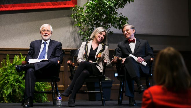 December 12, 2016 - (Left to right) Bill Michaelcheck, chairman of the board of trustees, sits beside Dr. Marjorie Hass as she touches William E. Troutt during an announcement that she's the new president of Rhodes College, the school's 20th president, during a press conference in the Bryan Campus Life Center on Monday. Hass replaces Troutt, who announced in April that he would step down as the school's president in June 2017.  Hass, 51, will assume her Rhodes duties on July 1, 2017.