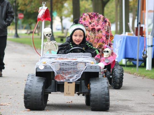 Gunner Harris, 5, races in his Halloween-themed four wheeler on this way to first place at the Count Krumnow's Tombstone Derby in Elmore on Saturday.