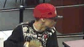 The US Bank at 3168 Harrison Ave. was robbed Monday afternoon. Pictured is the suspected robber.
