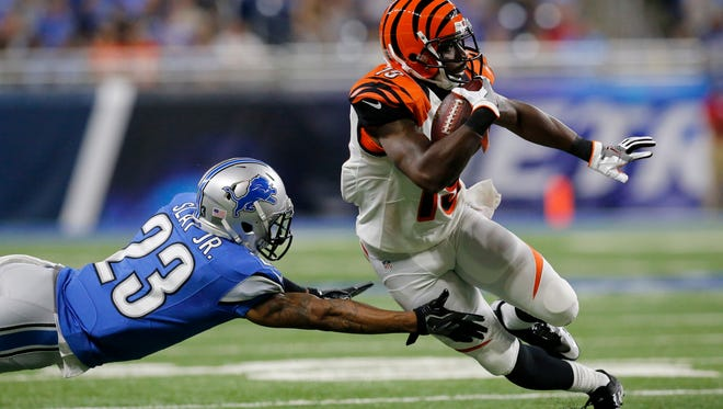 Cincinnati Bengals wide receiver Brandon Tate (19) cuts around a tackle attempt by Detroit Lions cornerback Darius Slay (23) on a reception in the first quarter of the NFL preseason game between the Detroit Lions and the Cincinnati Bengals at Ford Field in downtown Detroit on Thursday, Aug. 18, 2016.
