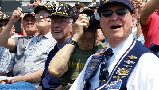 Four World War II veterans from Northern Kentucky and Indiana watch with awe during the flyover of planes from the World War II era.