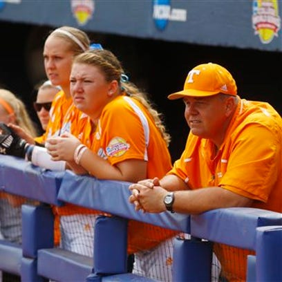 Tennessee co-coach Ralph Weekly, right, watches from