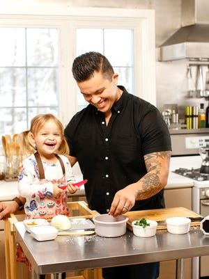 Steve Lara and his daughter having fun in the kitchen.