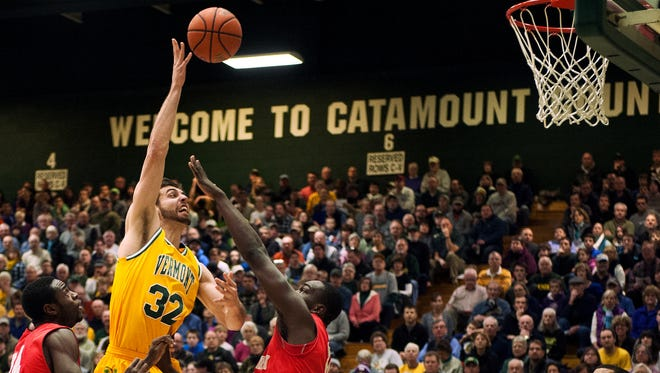 Catamounts forward Ethan O'Day (32) leaps to take a shot during the men's basketball game between the Stony Brook Seawolves and the Vermont Catamounts at Patrick Gym on Saturday afternoon January 10, 2015 in Burlington.
