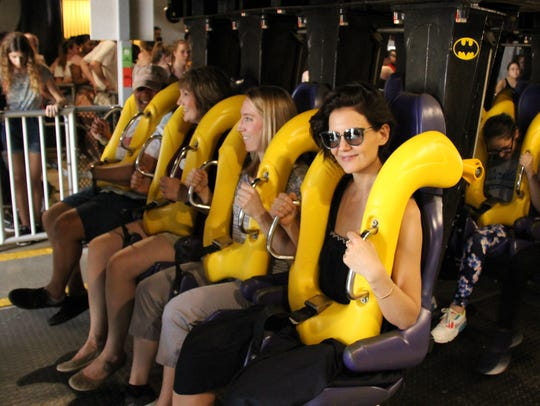 Katie Holmes, right, pictured on Batman: The Ride at