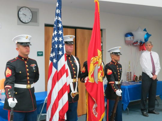 A ceremonial guard opens a reception at Deerlake Elementary School's All-American Heroes Rally in 2012.