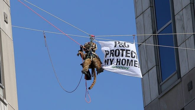Nine Greenpeace activists were indicted on charges of burglary and vandalism in April at Procter & Gamble's downtown Cincinnati headquarters.