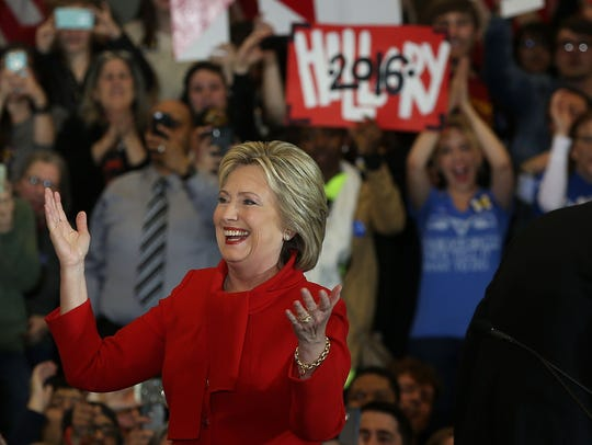 Hillary Clinton greets supporters during her caucus