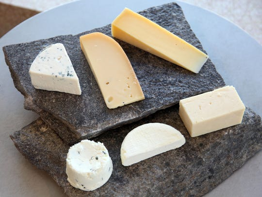 Clockwise from top left are Maytag Blue,  Frisian Farms Gouda, Milton Creamery Prairie Sunshine, Milton Creamery Prairie Breeze, Dairy Air Robiola and Northern Prairie Chevre, all made in Iowa.