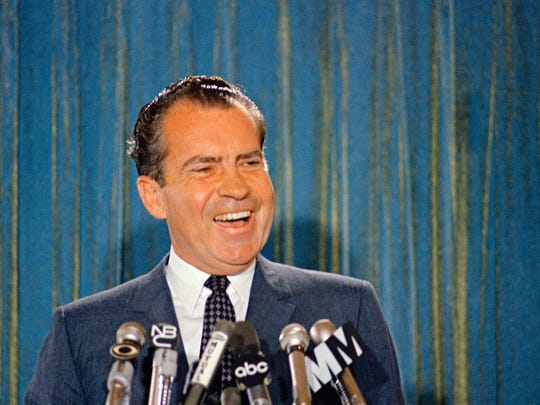 Republican presidential candidate Richard Nixon smiles during a news conference, 1968.  (AP Photo)