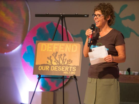 "Danielle Segura, Executive Director of Mojave Desert Land Trust, speaks to community members a the ""Mojave Monuments Rally"" in Indio at the Seventh-Day Adventist Church, organized by the Desert Defenders. The event goal was to educate the public on the possibility the federal government's potential removal of recently formed national monuments."