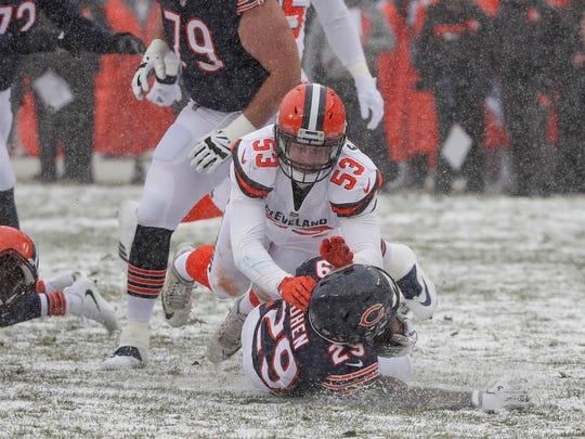 Browns linebacker Joe Schobert defends against Bears running back Tarik Cohen.