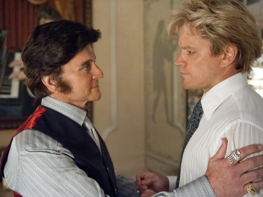 "Michael Douglas (left) and Matt Damon in star in the true-life drama ""Behind the Candelabra"" (2013)."