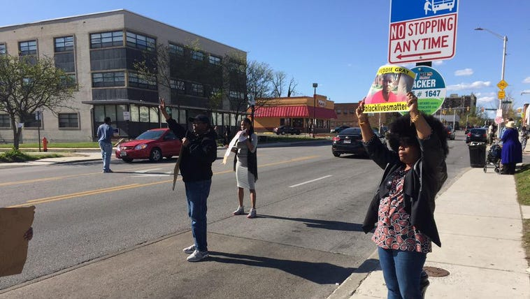 Outside Freddie Gray wake, demonstrators asking drivers