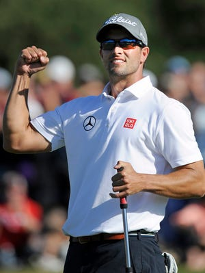 Adam Scott celebrates his second consecutive tournament victory.