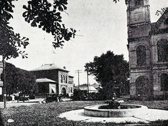 The view from Bellevue Street at the corner of Court Street around 1912 shows the fountain located on the North end of the St. Landry Parish Courthouse Square in downtown Opelousas.