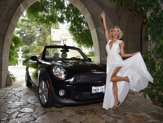 2015 Playmate of the Year Dani Mathers poses with her