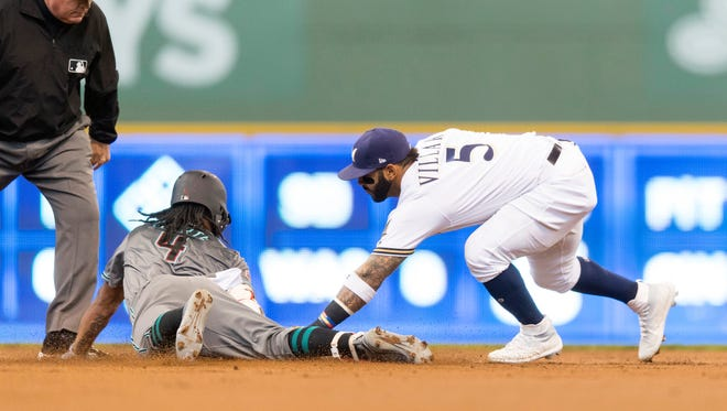 May 22, 2018: Milwaukee Brewers second baseman Jonathan Villar (5) tags out Arizona Diamondbacks shortstop Ketel Marte (4) at second base during the second inning at Miller Park.