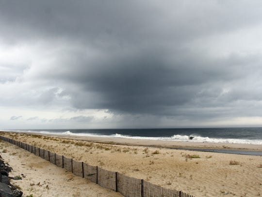 People out in Sea Bright beaches as rough weather moves in on the Jersey Shore area on Wednesday September 30,2015.