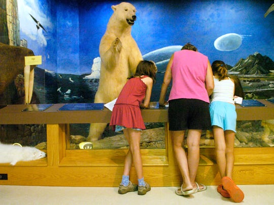 Maddie Nesbit of York, left, Jeni Ullery and Alix Ullery of Shrewsbury check a clue during a scavenger hunt at Richard M. Nixon County Park in 2008.