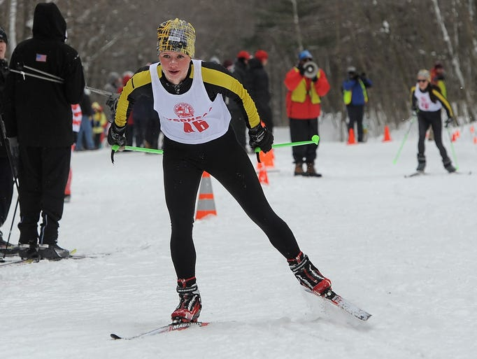 Honeoye Falls-Lima's Riley Douglas makes the final climb to the finish line at the 2014 NYSPHSAA Nordic Ski Championships at Harriet Hollister State Park on Monday, February 24, 2014.  Douglas finished first in the distance race with a time of 25:50.2.