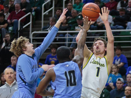 Clarkston?s Foster Loyer shoots over Grand Rapids Christian?s