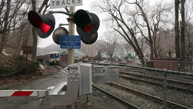 A southbound Metro-North train passes the Cleveland Street crossing in Valhalla. The town of Mount Pleasant is eying the Cleveland Street grade railroad crossing for closure. It has plans in place to build a road that would bring traffic to a nearby overpass.
