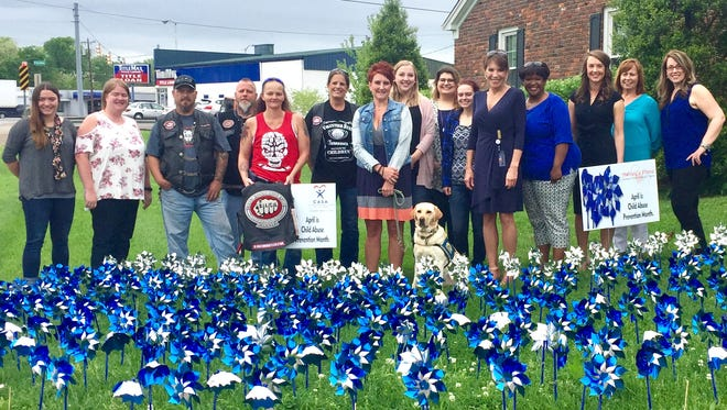 Mayor Paige Brown joined staff and volunteers with Sumner County CASA, Bikers Against Child Abuse and Ashley's Place to dedicate a pinwheel garden, raising awareness for Child Abuse Prevention Month in front of CASA in Gallatin Friday.