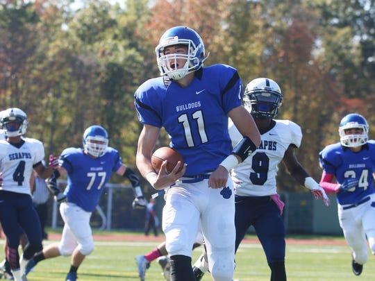 Metuchen's Trevor Firgau scores a touchdown. Mater Dei vs Metuchen football.  Metuchen, NJSaturday, October 25, 2014 Doug Hood/Staff Photographer