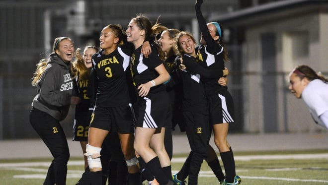 Viera players celebrate their win during Friday's Class 4A state soccer final.