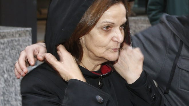 Rasmieh Yousef Odeh leaves the federal courthouse after her initial appearance before U.S. Magistrate Judge Michael Mason in Chicago.