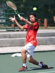 No. 7 Kai Kawano of Japan plays a backhand to return opponent No. 8 Seita Watanabe's serve in the Boys Singles event championship match of the 2016 Chuck E. Cheese's Junior Championships at the Rick Ninete Tennis Center in Hagåtña Saturday. Kawano won 7-6(6), 5-7, 6-1.