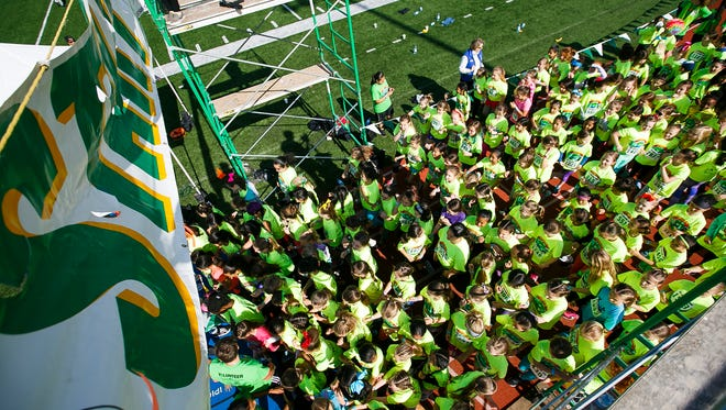 Third-grade girls line up at the start line for their run at the 35th annual Awesome 3000 on Saturday, May 6, 2017, at McCulloch Stadium in Salem, Ore.
