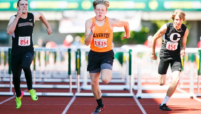 Silverton's Brock Rogers crosses the finish line in first in the 5A 110 hurdles at the 2017 OSAA track and field state championships on Saturday, May 20, 2017, at Hayward Field in Eugene, Ore.